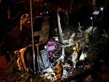 rescuers-walk-beside-a-crashed-bus-in-hong-kong
