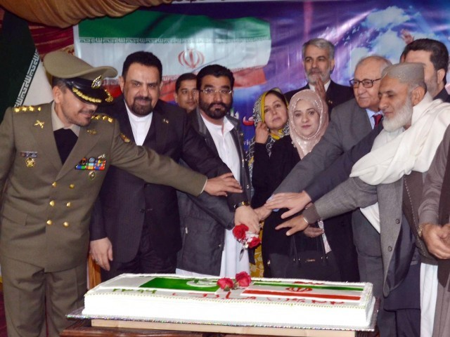 Balochistan Governor Mohammad Khan Achakzai and Iranian Consul General Agha Mohammad Rafiei along with others cut a cake during a ceremony to celebrate the 39th Anniversary of the Islamic Revolution in Iran. PHOTO: ONLINE