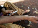 a-man-injects-heroin-into-his-arm-along-a-street-in-man-sam-northern-shan-state-myanmar-3-2