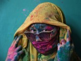 a-woman-poses-for-a-photograph-during-holi-celebrations-in-the-town-of-barsana-in-the-state-of-uttar-pradesh-2-2