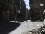 a-girl-stands-in-a-damaged-street-in-ain-tarma-in-eastern-ghouta-a-suburb-of-damascus-3-2