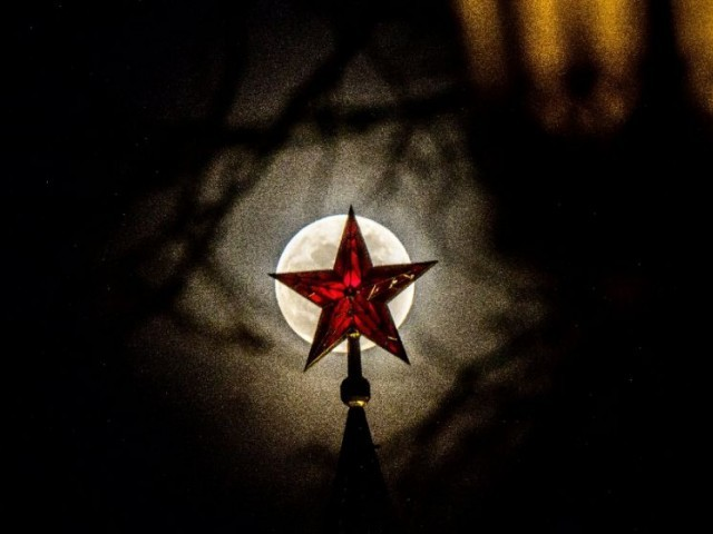 The full moon rises behind one of the Kremlin's ruby stars in Moscow. PHOTO: AFP