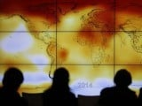 participants-looks-at-a-screen-projecting-a-world-map-with-climate-anomalies-during-the-world-climate-change-conference-2015-cop21-at-le-bourget-3-2-2-2-3-2-2-2-2-2-2-3-2-3