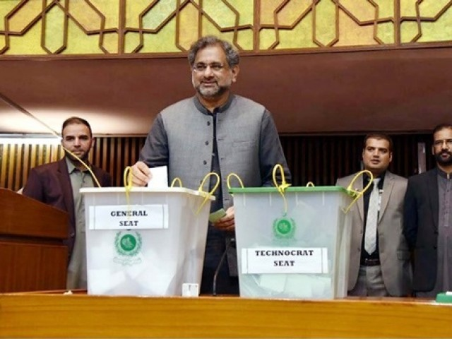 Prime Minister, Shahid Khaqan Abbasi casts his vote during Senate Election held at Parliament House in Islamabad on Saturday. PHOTO: PPI