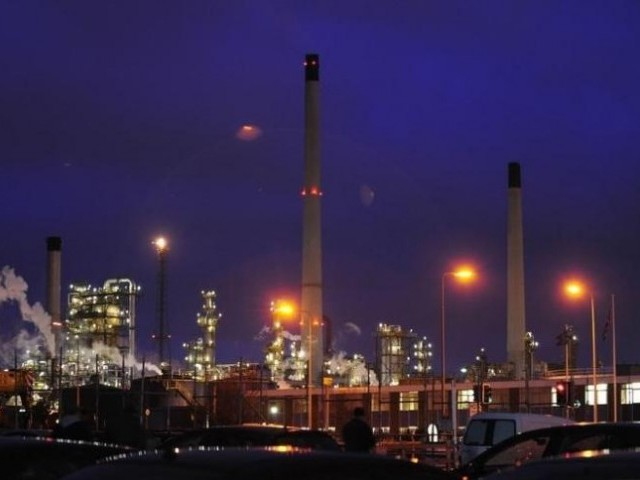 Lights shine within an oil refinery. PHOTO: REUTERS
