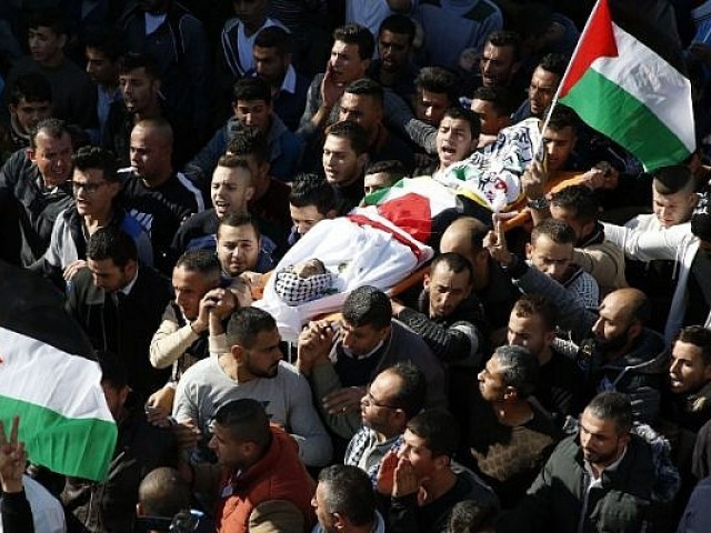 Mourners carry the body of Mohammed Aqal, a Palestinian killed after carrying out a stabbing attack on a Border Police officer, during his funeral in the West Bank village of Beit Ula. PHOTO: AFP