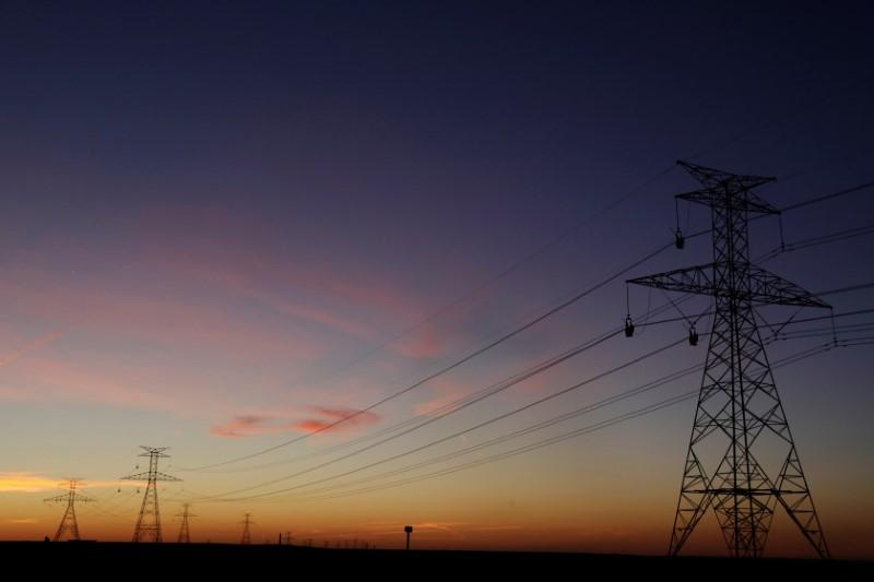 the-sun-sets-behind-power-lines-above-the-plains-north-of-amarillo-texas