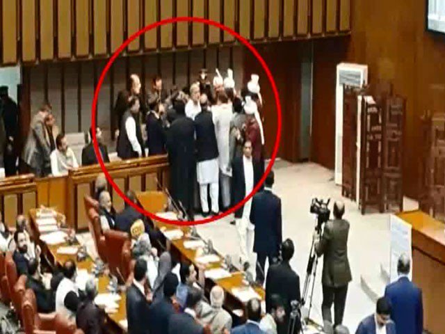 Fight breaks out after announcement of Sanjrani's election as Senate chairman. PHOTO: EXPRESS