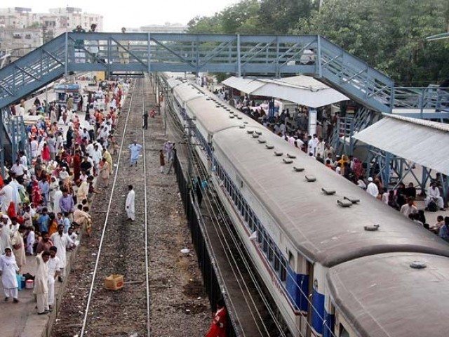 People waiting for their trains at Karachi Railway Station. PHOTO: AFP