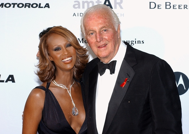 24 2002 French fashion designer Hubert de Givenchy and Somalian-born model Iman pose for