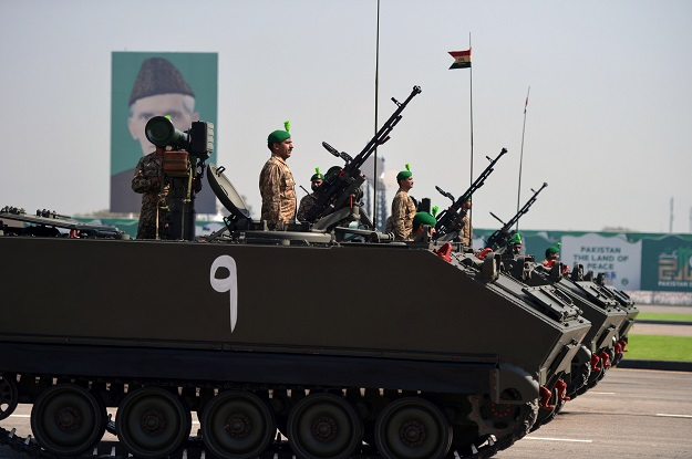 Pakistani tank crews steer their vehicles during the Pakistan Day military parade in Islamabad on March 23, 2018. PHOTO: AFP