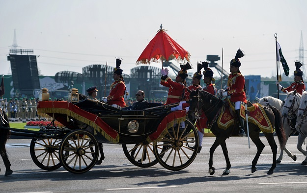 Pakistan's President Mamnoon Hussain (C) rides a horse-drawn carriage escorted by presidential guards as he arrives at the venue for the Pakistan Day military parade in islamabad on March 23, 2018. PHOTO: AFP