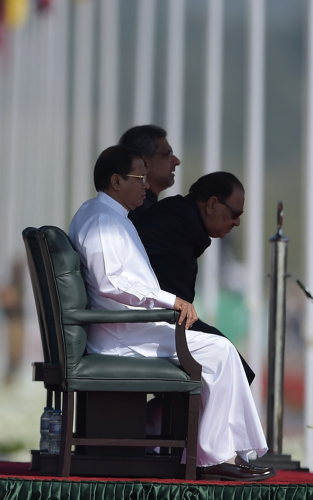 Pakistan's President Mamnoon Hussain (R), Sri Lankan President Maithripala Sirisena (L) and Pakistani Prime Minister Shahid Khaqan Abbasi attend the Pakistan Day military parade in Islamabad on March 23, 2018. PHOTO: AFP