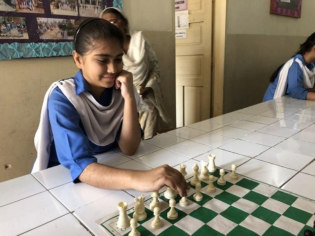 Chess player Bushra Maqsood at SMB Fatima Jinnah Government Girls School, in Karachi, Pakistan. She says she loves playing with an opponent who can give her a really tough time. Picture taken February 24, 2017. PHOTO: Thomson Reuters Foundation