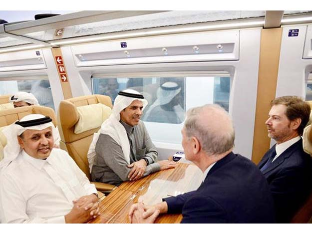 Saudi officials and foreign visitors seen in one of the 'Haramain Express' trains during a test-run of the mass transport system. PHOTO COURTESY: Saudi Press Agency