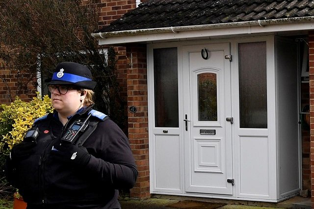 A police officer stands guard outside of the home of former Russian military intelligence officer Sergei Skripal, in Salisbury, Britain, March 6, 2018. PHOTO: Reuters