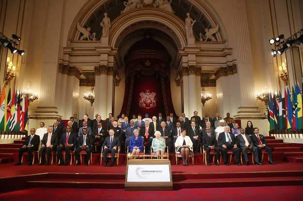 Commonwealth leaders pose for a family photograph with Britain's Queen Elizabeth II at the formal opening of the Commonwealth Heads of Government Meeting (CHOGM) at Buckingham Palace in London on April 19, 2018. The countries represented have been identified as: (back row, L-R) Barbados, Belize, St Vincent and The Grenadines, Malaysia, Tanzania, Zambia, Sierra Leone, Botswana, South Africa, Solomon Islands, Pakistan, The Bahamas, Mauritius, The Gambia. (second row from back, L-R) Ghana, Seychelles, St Lucia, Kiribati, Vanuatu, Jamaica, Canada, Australia, Trinidad and Tobago, Guyana, Lesotho, Namibia, St Kitts and Nevis, Mozambique. (second row from front row, L-R) Sri Lanka, Tonga, Fiji, Antigua and Barbuda, Malawi, India, Nigeria, Tuvalu, Nauru, Kenya, Cyprus, PNG, Cameroon, Bangladesh, New Zealand. (front row, L-R) Swaziland, Singapore, Dominica, Grenada, Malta, United Kingdom, Britain's Queen Elizabeth II, Commonwealth Secretary. PHOTO: AFP