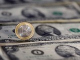 u-s-dollar-note-and-a-euro-coin-are-seen-in-this-picture-illustration