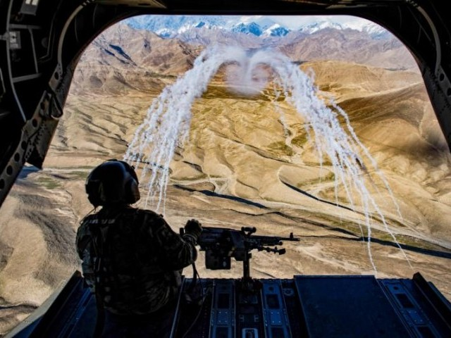 A US Army crew chief flying on board a CH-47F Chinook helicopter observes the successful test of flares during a training flight in Afghanistan. PHOTO: REUTERS
