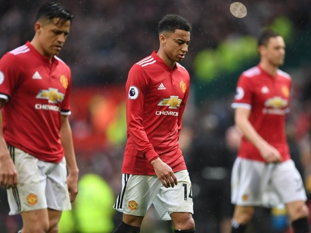 Manchester United's English midfielder Jesse Lingard (C) walks off after the English Premier League football match between Manchester United and West Bomwich Albion at Old Trafford in Manchester, north west England, on April 15, 2018. Manchester City were crowned Premier League champions on Sunday as Manchester United crashed to a shock 1-0 defeat against West Bromwich Albion. PHOTO: AFP