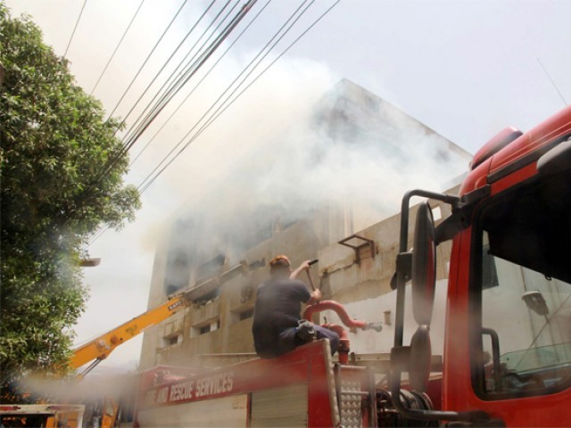 Efforts continued on Friday to put out flames at Lucky Textile Mills. PHOTO: PPI