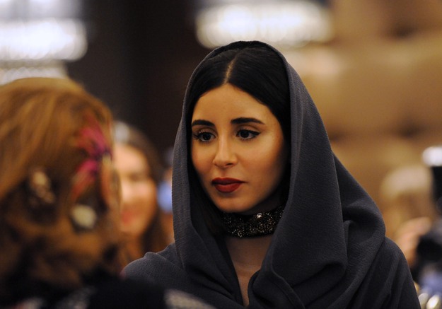 Women attend the opening ceremony of Arab Fashion Week, on April 10, 2018, at Ritz Carlton hotel in Riyadh. / AFP PHOTO / FAYEZ NURELDINE