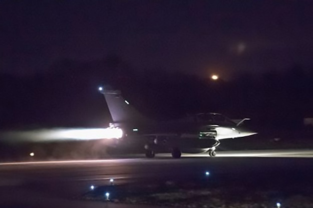 This photograph obtained April 14, 2018 from the Twitter account of French Defense Minister, Florence Parly, shows French military aircraft launching early April 14, 2018, as western strikes hit Syrian military bases and research centres in and around the capital and the country's centre, a monitor said, as the US, France, and Britain announced a joint operation. PHOTO: AFP