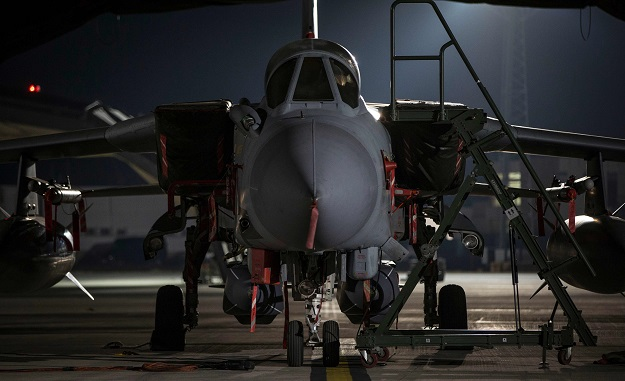 "A Royal Air Force tornado with 2 storm shadow missiles sits on the pan in the early hours from RAF Akrotiri airbase in Cyprus to conduct air strikes in Syria on April 14, 2018. Four Tornado jets fired Storm Shadow missiles ""at a military facility -- a former missile base -- some 15 miles (24 kilometres) west of Homs, where the regime is assessed to keep chemical weapon precursors,"" the defence ministry said in a statement PHOTO: AFP"