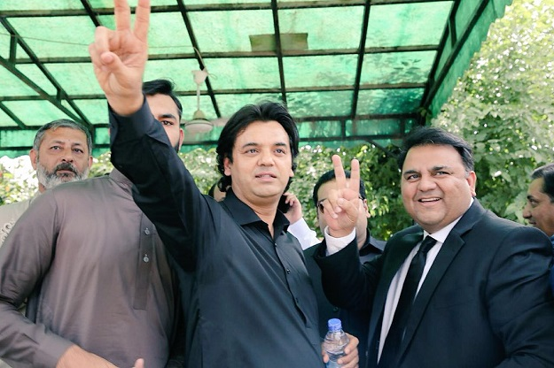 Petitioner and PTI leader Usman Dar celebrates IHC verdict with Fawad Chaudhry. PHOTO: PTI OFFICIAL