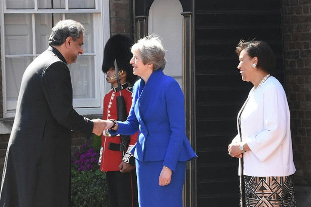 Prime Minister Shahid Khaqan Abbasi greets British PM May. PHOTO: PM OFFICE