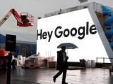 file-photo-a-man-walks-through-light-rain-in-front-of-the-hey-google-booth-under-construction-at-the-las-vegas-convention-center-in-preparation-for-the-2018-ces-in-las-vegas