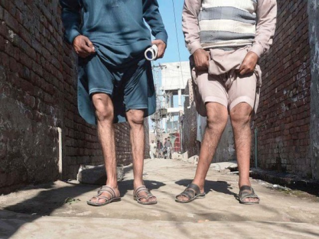 Two residents show their deformed legs. PHOTO: AFP