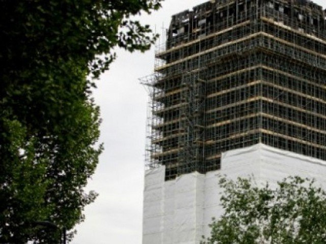 Britain will spend £400 million stripping high-rise buildings of the dangerous cladding blamed for last year's Grenfell Tower fire which claimed the lives of 71 people. PHOTO: AFP