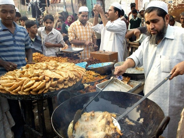 A food seller fries pakora. PHOTO: AFP