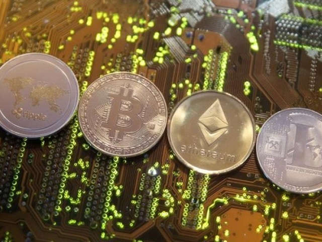 Representations of the Ripple, Bitcoin, Etherum and Litecoin virtual currencies are seen on a PC motherboard in this illustration picture, February 13, 2018. PHOTO: REUTERS