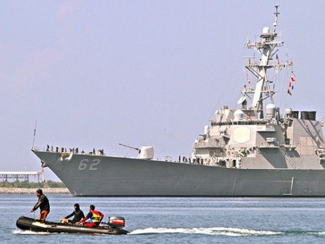 China warns U.S. vessels to leave disputed waters