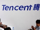 file-photo-visitors-use-phones-underneath-of-logo-of-tencent-at-global-mobile-internet-conference-in-beijing