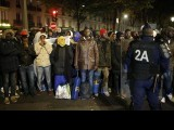 migrants-wait-before-entering-buses-as-part-of-their-transfer-by-french-authorities-to-reception-centres-across-the-country-during-the-dismantlement-of-makeshift-camps-in-a-street-near-stalingrad-me-2