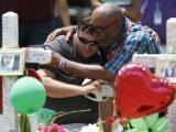 people-embrace-at-a-makeshift-memorial-left-in-memory-of-the-victims-killed-in-a-shooting-at-santa-fe-high-school-in-santa-fe