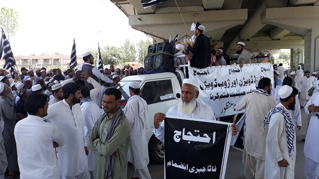 JUI-F staging protest in Peshawar. PHOTO: EXPRESS