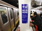 file-photo-a-sign-advertises-wi-fi-service-in-the-times-square-subway-station-in-new-york
