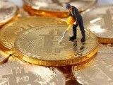 a-small-toy-figure-is-seen-on-representations-of-the-bitcoin-virtual-currency-in-this-illustration-picture-3