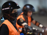 A picture taken June 3, 2018 shows Saudi Noura preparing for a training session at the Bikers Skills Institute, a motorcycle driving school, on the outskirts of Riyadh. Even a year ago, it would have been hard to imagine -- Saudi women clad in skinny jeans and Harley Davidson t-shirts, revving motorbikes at a Riyadh sports circuit. But ahead of the historic lifting of a decades-long ban on female drivers on June 24, women gather weekly at the privately owned Bikers Skills Institute, to learn how to ride bikes.   PHOTO: AFP