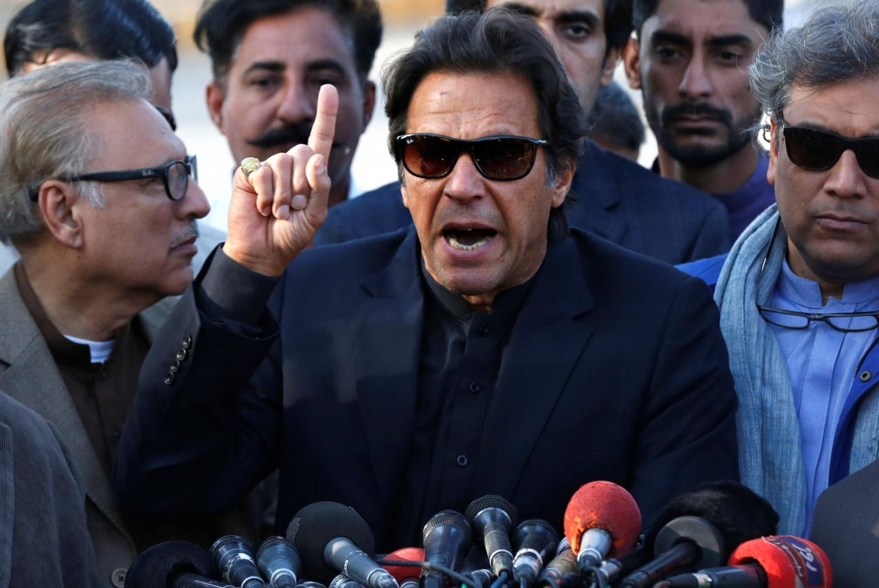 imran-khan-chairman-of-the-pakistan-tehreek-e-insaf-political-party-gestures-as-he-addresses-members-of-the-media-outside-jinnah-intern
