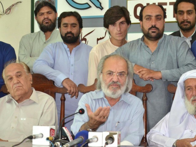 Pakistan Tehreek-e-Insaf leader Humanyun Jogezai addressing a press conference at the Quetta Press Club. PHOTO: ONLINE