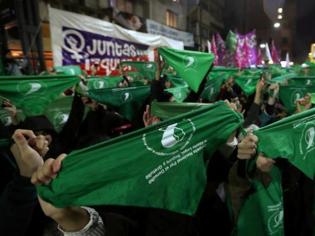 Demonstrators hold up green handkerchiefs during a demonstration in favor of legalizing abortion outside the Congress in Buenos Aires, Argentina, PHOTO: REUTERS.
