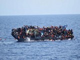 migrants-are-seen-on-a-capsizing-boat-before-a-rescue-operation-by-italian-navy-ships-bettica-and-bergamini-off-the-coast-of-libya-2