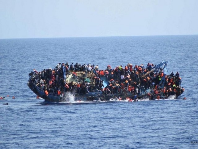 Migrants are seen on a boat near Italy. PHOTO: REUTERS