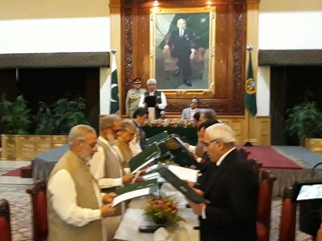 Oath was administered by Governor K-P Iqbal Zafar Jhagra. PHOTO: EXPRESS