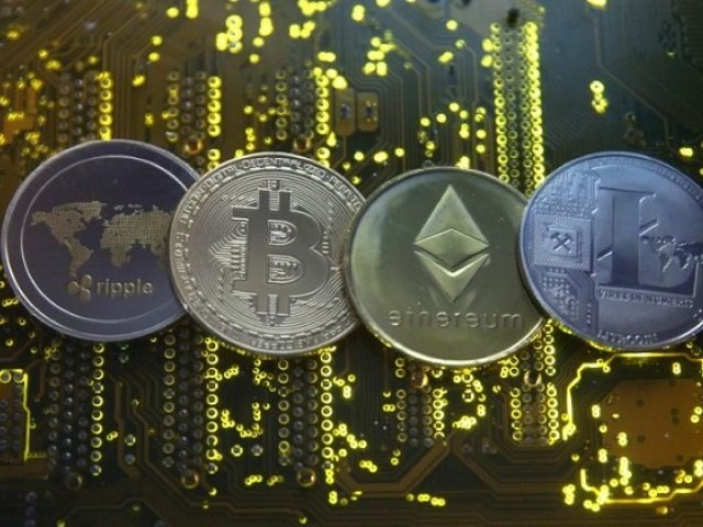 Representations of the Ripple, Bitcoin, Etherum and Litecoin virtual currencies are seen on a PC motherboard in this illustration picture, February 14, 2018. PHOTO: REUTERS